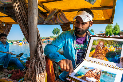 Photography studios are housed in a shikara and offer their services to the tourists who come for a shikara ride in the Dal lake at Srinagar.