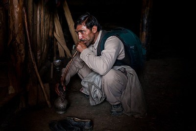 The tourist guide on our day trek to Dragdolan near Yusmarg in Kashmir takes a hookah break in a Gujjar house.