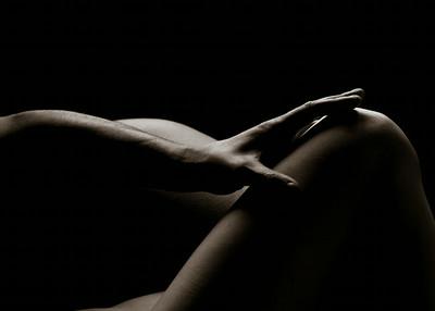 Touching her leg