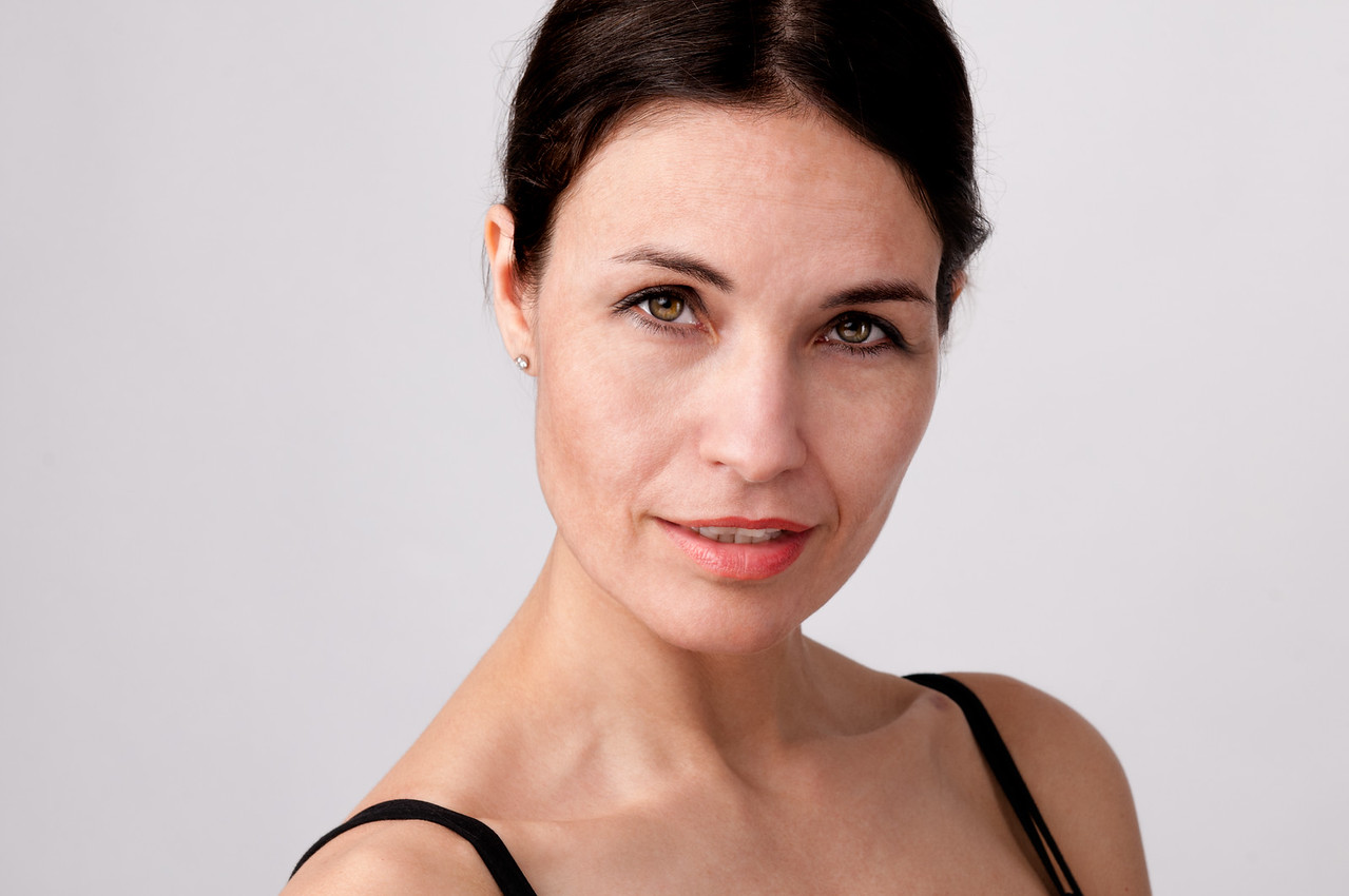 Headshot of woman with  latin look