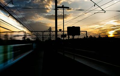 Sunrise and moving train