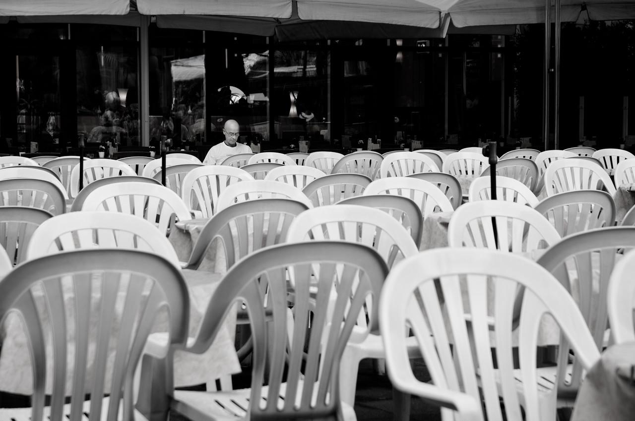 Man behind chairs