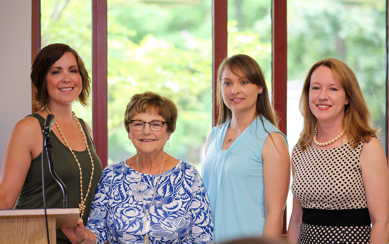 From left are Senior and Social Services Director Claire Côté, honoree Kathy Corkum, Senior Center Coordinator Nicole Carrasquillo and first selectwoman Leslee Hill. <br /> Photo by John Fitts