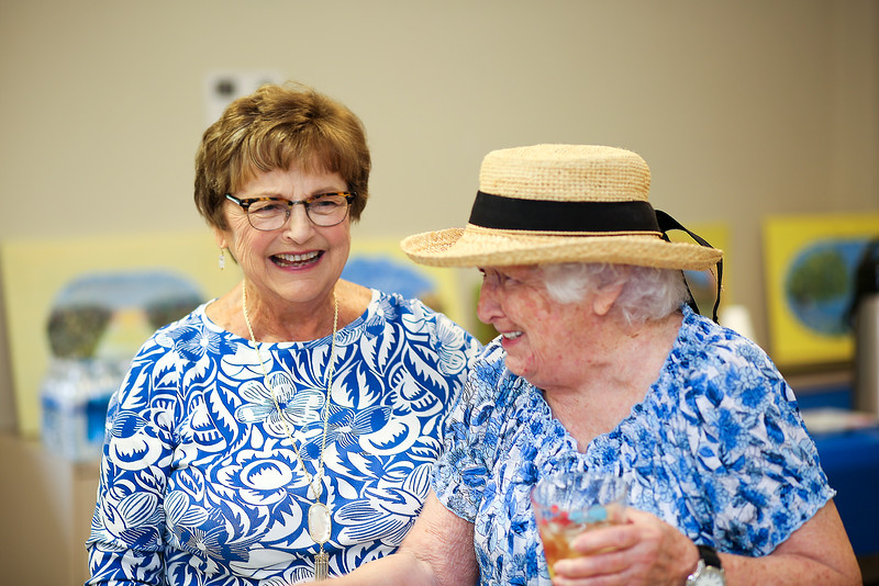 Honoree Kathy Corkum shares a laugh with Margaret Sangster.<br /> Photo by John Fitts