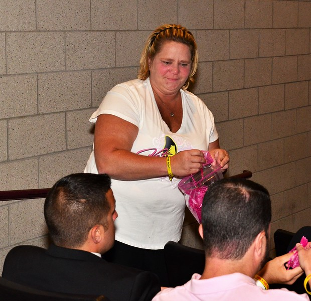 Katie laBelle's Aunt, Molly Paine giving out Pink Bows at Katie LaBelle's Memorial.