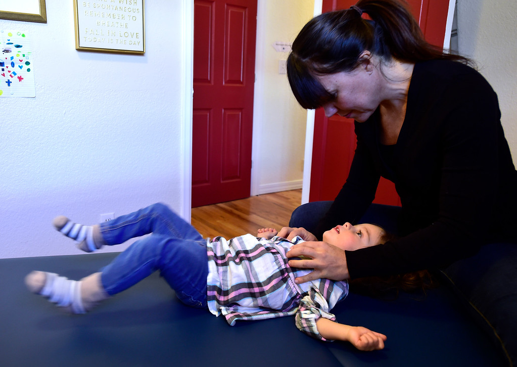 . LOUISVILLE, CO - NOVEMBER 13, 2018  Katie Morrell, a NeuroMovement Practitioner works with Caroline Joseph, 2, in the Louisville Family Center on Tuesday morning. For more photos go to dailycamera.com (Photo by Paul Aiken/Staff Photographer)