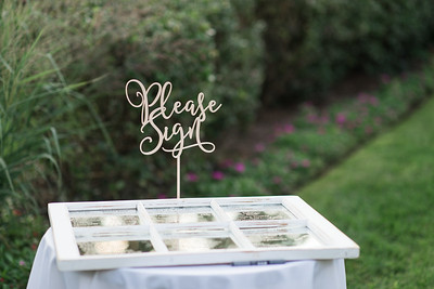 Tawney & Tyler had all of their guests sign a distressed mirror/window at their reception @ Regents Glen