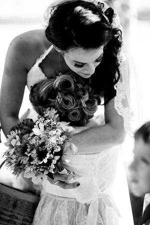"""Amy hugging her flower girl right after her & Mat said """"I DO"""""""