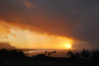Afternoon view of rainclouds and sun from Kilauea lighthouse road