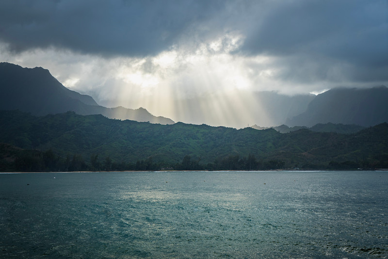 Hanalei Bay as rain clouds part.  Warm and tropical; looks may be deceiving.