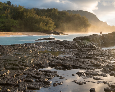 Fisherman in golden mist of sunset on Lumahai Beach, Kauai