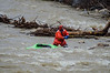 DAVID LACHANCE — BENNINGTON BANNER<br /> A member of the North Bennington Cold Water Support Team wades into the rain-swollen Roaring Branch of the Walloomsac River on Monday to retrieve a kayak. The kayak's owner was found safe, out of the water. Emergency crews responded around 4:30 p.m. when the kayak was spotted near the Park Street bridge.