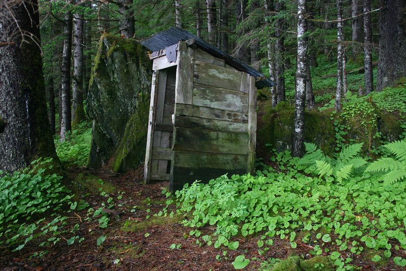 During a rest break on day 2, we found some old buildings in the forest including this outhouse.