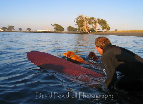 "Doug, Cody, and Sam at the Humboldt Bay launch.  Doug's handmade classic ""old school"" surfboard."
