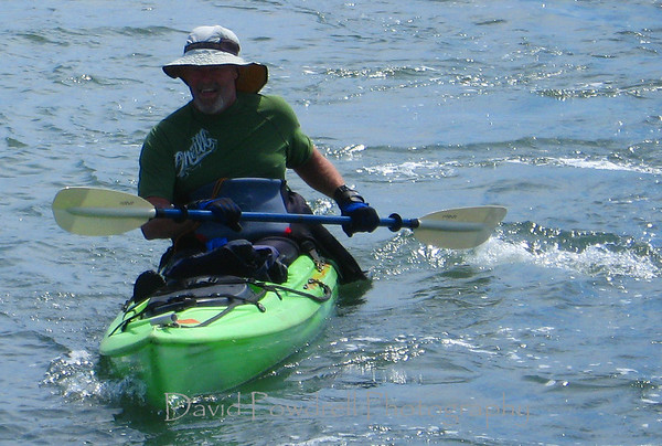 "Final stroke of his paddle after paddling 1109 miles of the California coast in ""Tupperware"".  Johnny ""Lonewolf"" Beardsmore."