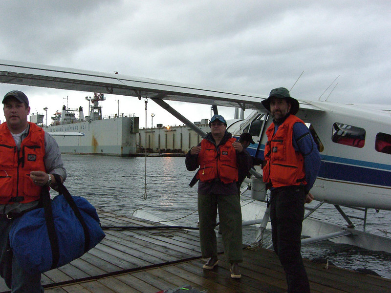 The pilot, Martin, and Dave gettng ready to drop off supplies at Claude Point.