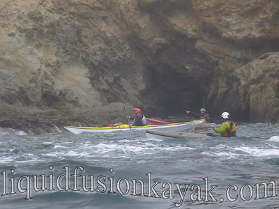 Positioning to explore a sea cave.
