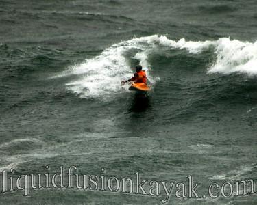 Jeff surfs the stormy waves at Steamer's Lane in the 2011 Santa Cruz Paddlefest.
