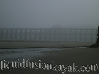 Fog envelopes the trestle.