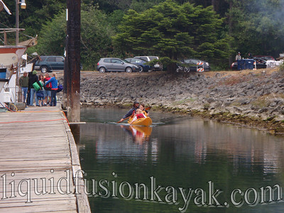 Kids kayaking in Fort Bragg's Noyo Harbor.