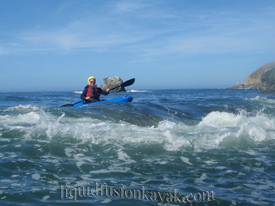 Ocean kayaking in waves and whitewater in Fort Bragg, California.