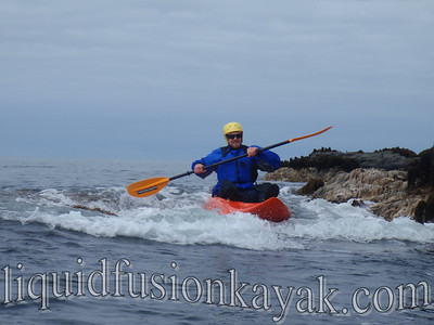 Paddling and playing in the whitwater of the sea.