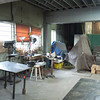 The metal shop area of Shop People.  Under the tarps are a Bridgeport, a 12x36 lathe, a bandsaw, and other tools.
