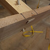 """There are two pegs holding each deck rail in place.  A 1/8"""" through the top, and a 1/4"""" on a diagonal.  This is a strong joint (and no glue)."""