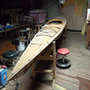 plywood boat in the corner of the work space