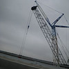 Crane working on the new lanes on I-10 on the bridge over the Trinity River.