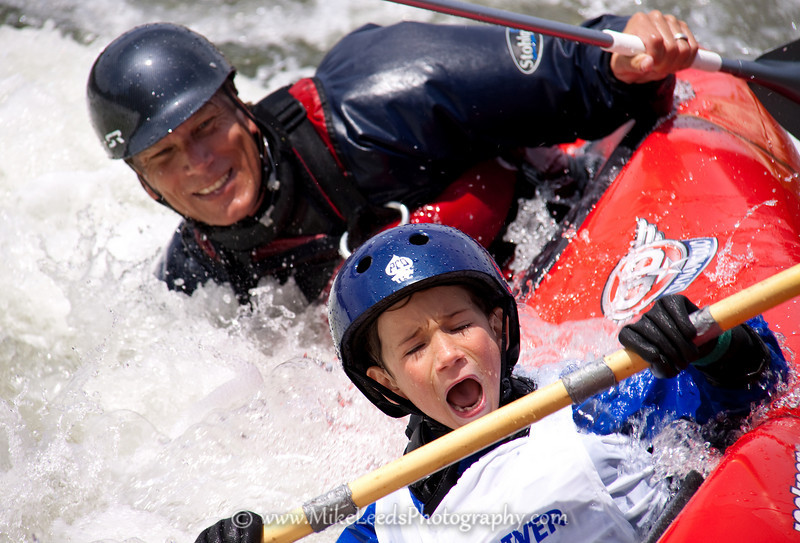 Jimmy Grossman and his son Buey surfing the Dynamic Duo, two person hardshell kayak, on the Main Payette River in Idaho.