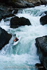 Paddler Brian Ward on the last drop of Big Falls. South Fork Payette River in Idaho.