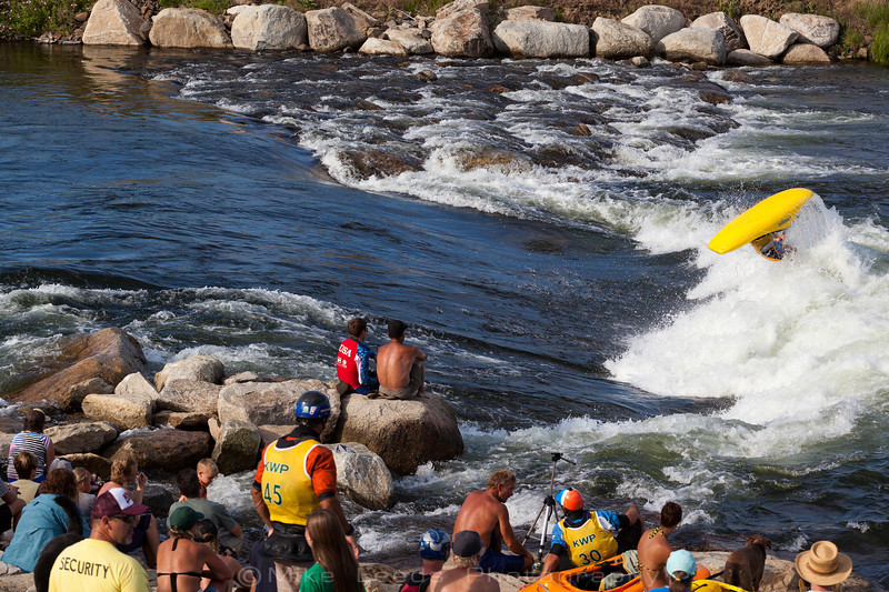 Dane Jackson with a nice Air-Loop at Kelly's Whitewater Park in Cascade Idaho during the USA Freestyle Kayaking Nationals. 2012