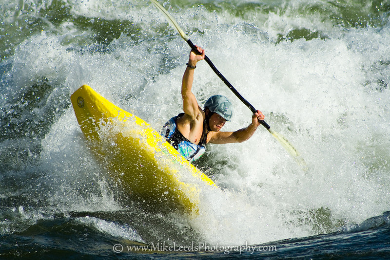 "Paddler Will Parham with a ""Clean Blunt"" at Climax Surf Wave on the Main Payette River in Idaho."