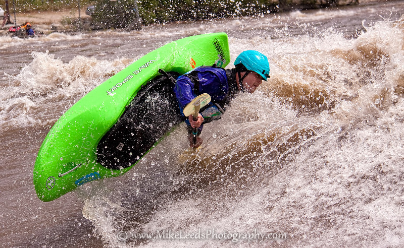 "Paddler Will Parham with a nice ""Pan-Am"" at the Bladder Wave. Main Payette River in Idaho."