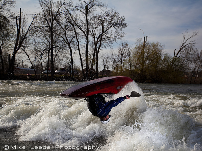 Alec Voorhees with a big loop at the Boise Whitewater Park on an April evening.
