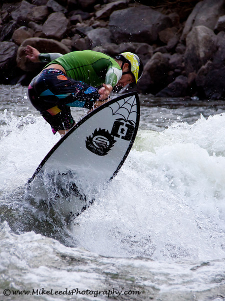 Surfing on the Constriction Wave, Main Payette River, Idaho.