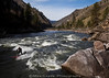 Chris Peterson carving up Golds Hole on an April morning. Main Salmon River in Idaho.