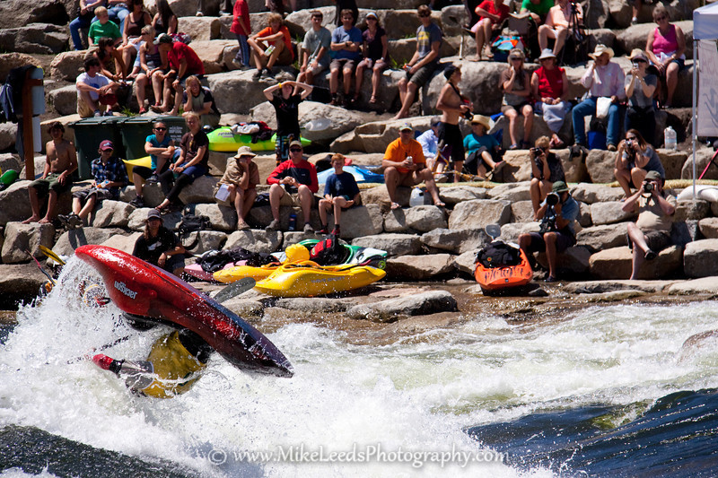 "Alec Voorhees with a big ""Air-loop"" at Kelly's Whitewater Park during the USAFK Championship. North Fork Payette River, Cascade Idaho."