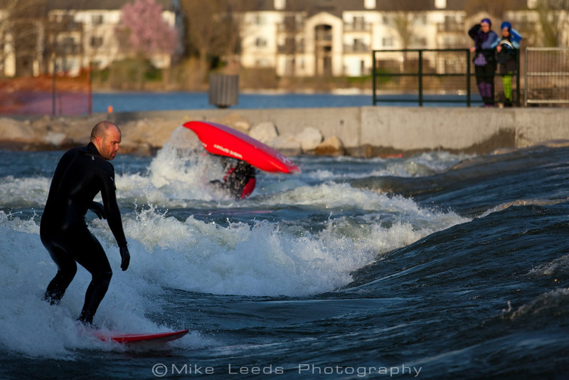 The new Boise Whitewater Park on an April evening during high water. Chris Peterson on the Surf Board and Dan Simenc in the Kayak.