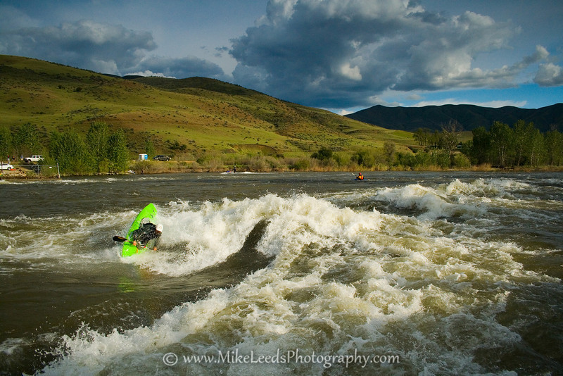Paddler Mark Cecchini throwing down at the Bladder Wave. Main Payette Rive in Idaho.