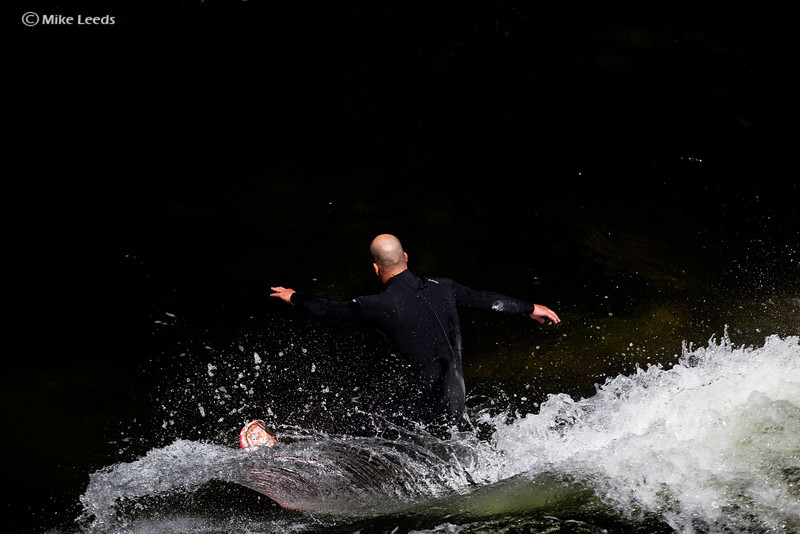Chris Peterson carving on his surfboard at Pipeline Wave on the Lochsa River in Idaho.
