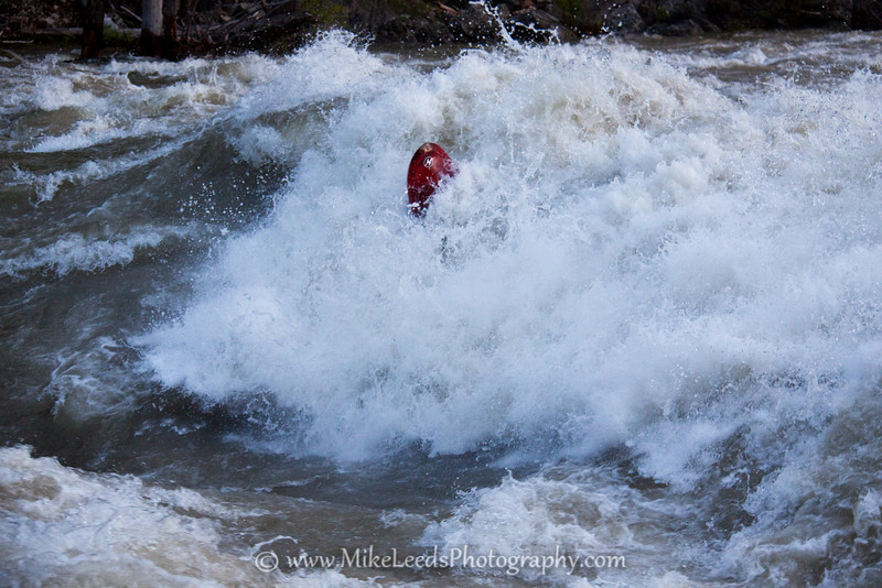 Ethan McLeod getting a couple cartwheels while taking the Hero Line in a Project  X56.  Slalom Rapid on the South Fork Payette River in Idaho.