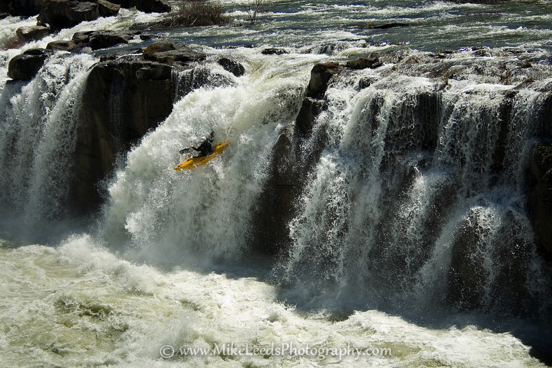 Paddler Ted Keyes running the high water line at Star Falls, Snake River in Idaho.