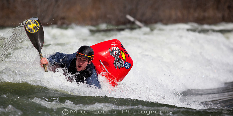 "Dan Simenc cartwheeling on a sunny afternoon in March at the ""Barber Park"" wave on the Boise River in Idaho."