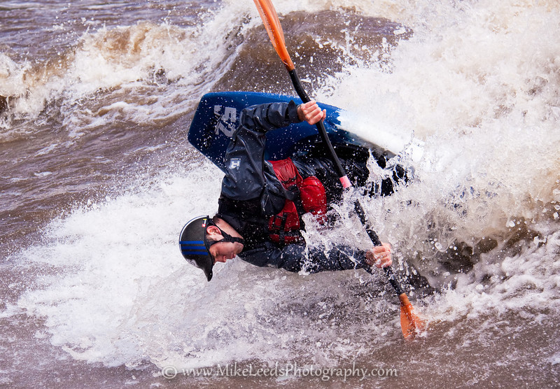 "Paddler Tyler Allyn sticking a ""Pistol Flip"" at the Bladder Wave on the Main Payette River in Idaho."