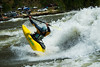 "Paddler Will Parham with a ""Clean Blunt"" at the Bladder Wave on the Main Payette River in Idaho."