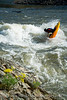 Kayaker with a Blunt at Trimax Surf Wave on the Main Payette River in Idaho.