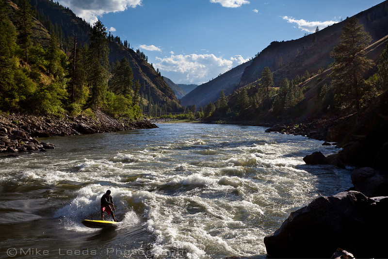 Mike Tavares carving up Golds Hole on his Badfish Stand Up Paddle Board on the Main Salmon River in Idaho on a hot July afternoon.
