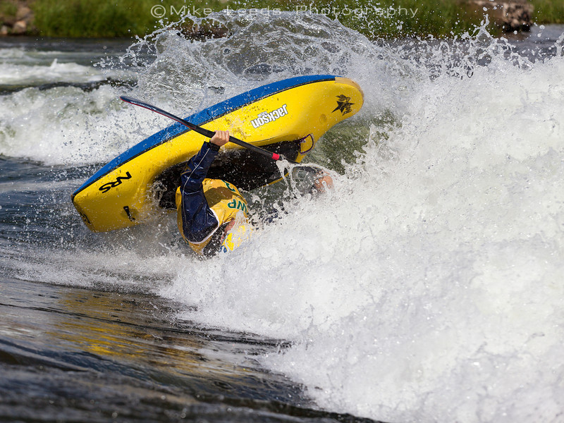 Stephen Wright with a super fast and clean Helix at Kelly's Whitewater Park during the USA Freestyle Kayaking Nationals in Cascade Idaho. 2012